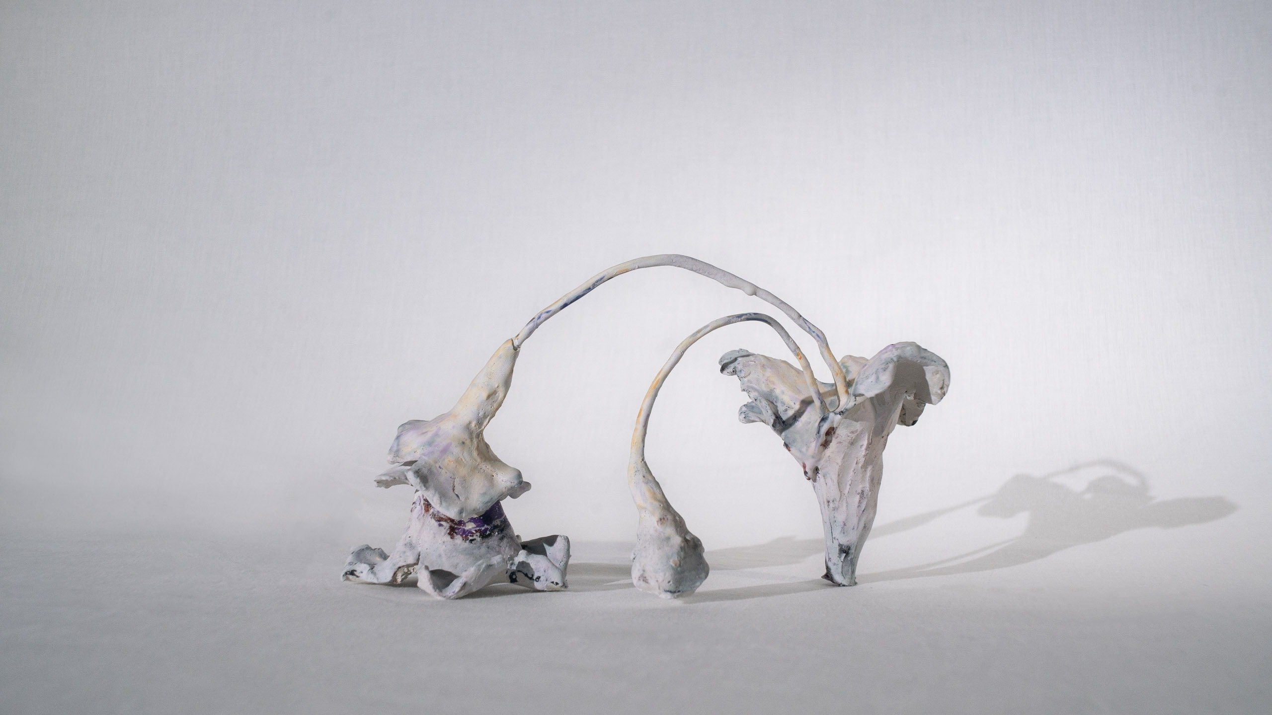 Small clay flower sculpture by artist Carrie Ruddick.